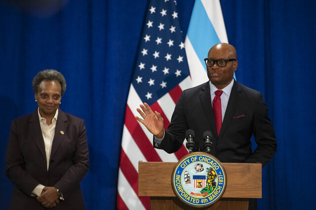 Former Dallas Police Chief David Brown, right speaks to reporters after Mayor Lori Lightfoot, left, nominated him to be Chicago's next police superintendent Thursday, April 2, 2020. (Tyler LaRiviere/Chicago Sun-Times via AP)