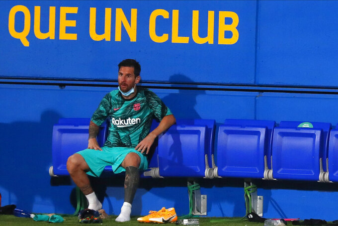 Barcelona's Lionel Messi sits on the bench during the pre-season friendly soccer match between Barcelona and Girona at the Johan Cruyff Stadium in Barcelona, Spain, Wednesday, Sept. 16, 2020. (AP Photo/Joan Monfort)