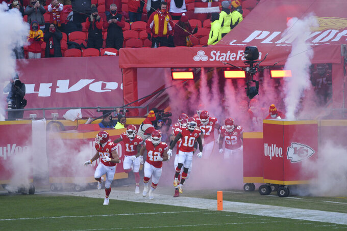 Kansas City Chiefs players run onto the field before an NFL divisional round football game against the Cleveland Browns, Sunday, Jan. 17, 2021, in Kansas City. (AP Photo/Reed Hoffmann)