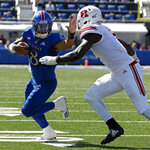 Kansas quarterback Miles Kendrick (8) runs under pressure from Rutgers defensive lineman Elorm Lumor (7) during the first half of an NCAA college football game Saturday, Sept. 15, 2018, in Lawrence, Kan. (AP Photo/Charlie Riedel)
