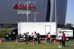 San Francisco 49ers defensive players run drills during NFL football practice in front of State Farm Stadium, home of the Arizona Cardinals, Thursday, Dec. 3, 2020, in Glendale, Ariz. The 49ers start a three-week road trip after being forced from their stadium and practice facility because of strict new COVID-19 protocols in their home county in Northern California. (AP Photo/Ross D. Franklin)