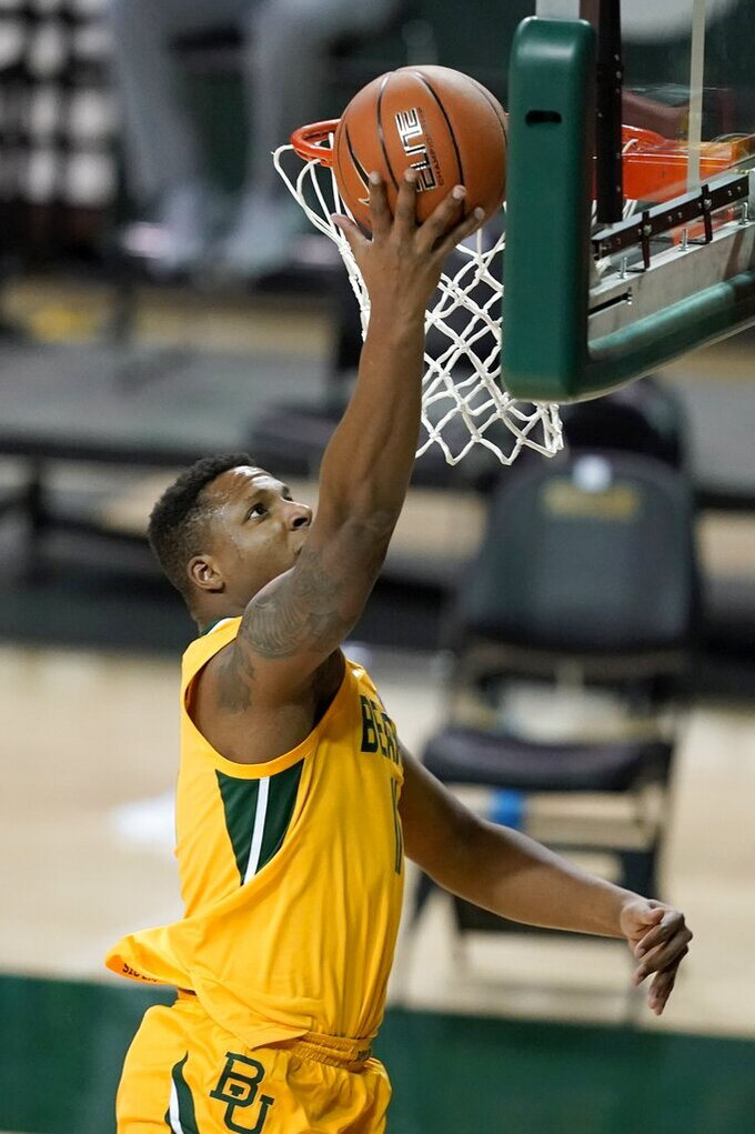 Baylor guard Mark Vital goes up for an uncontested shot during the first half of the team's NCAA college basketball game against Stephen F. Austin in Waco, Texas, Wednesday, Dec. 9, 2020. (AP Photo/Tony Gutierrez)
