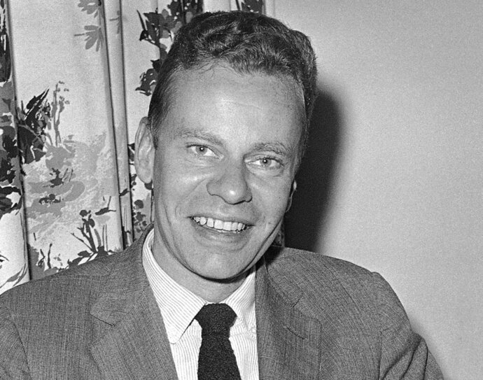 FILE - This Oct. 14, 1959 file photo shows Charles Van Doren at New York's hotel Roosevelt. Van Doren, who admitted his television quiz show performances in the 1950s had been rigged, died on Tuesday, April 9, 2019, in Canaan, Conn. He was 93. (AP Photo, File)