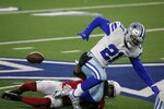 Arizona Cardinals safety Budda Baker (32) strips the ball from Dallas Cowboys running back Ezekiel Elliott (21) in the first half of an NFL football game in Arlington, Texas, Monday, Oct. 19, 2020. (AP Photo/Michael Ainsworth)