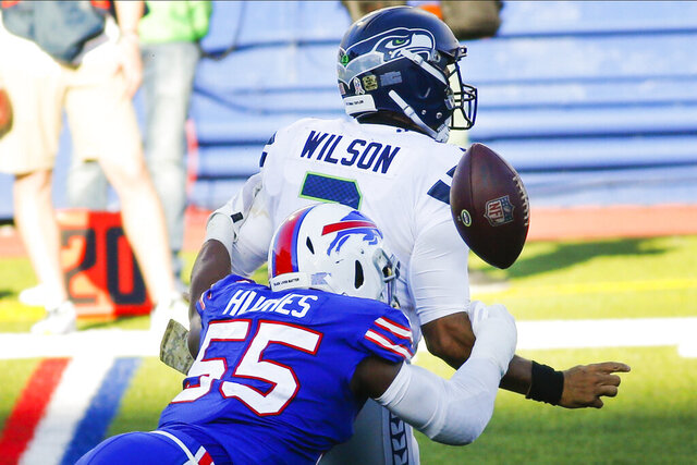 Buffalo Bills' Jerry Hughes (55) knocks the ball away from Seattle Seahawks' Russell Wilson (3) to force a fumble during the second half of an NFL football game Sunday, Nov. 8, 2020, in Orchard Park, N.Y. The Bills recovered the ball. (AP Photo/Jeffrey T. Barnes)