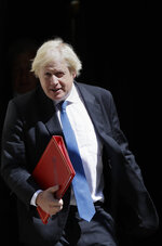 Britain's Foreign Minister Boris Johnson leaves 10 Downing Street in London, Wednesday, June 13, 2018. (AP Photo/Kirsty Wigglesworth)