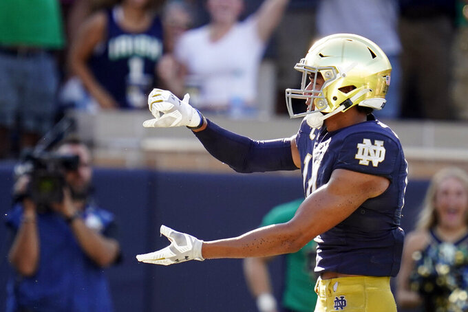 Notre Dame safety Kyle Hamilton (14) celebrates an interception in the end zone against Purdue during the second half of an NCAA college football game in South Bend, Ind., Saturday, Sept. 18, 2021. Notre Dame defeated Purdue 27-13. (AP Photo/Michael Conroy)