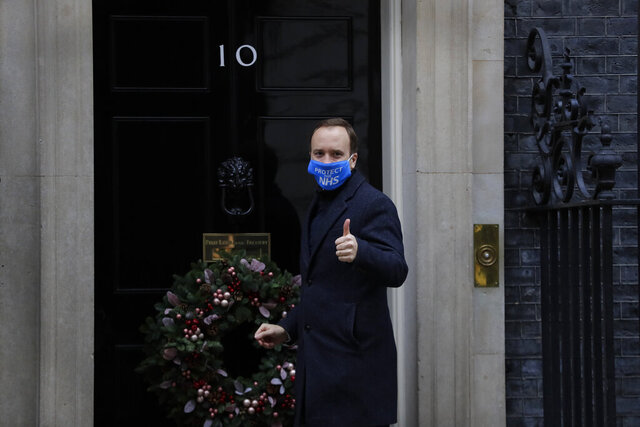Britain's Health Secretary Matt Hancock gestures as he arrives at Downing Street in London, Wednesday, Dec. 2, 2020. U.K. Health Secretary Matt Hancock on Wednesday thanked scientists from Pfizer and BioNTech after the approval of their COVID-19 vaccine for emergency use by the country's drugs regulator. Speaking earlier Hancock gave details of how the vaccine would be distributed from the beginning of next week. (AP Photo/Kirsty Wigglesworth)