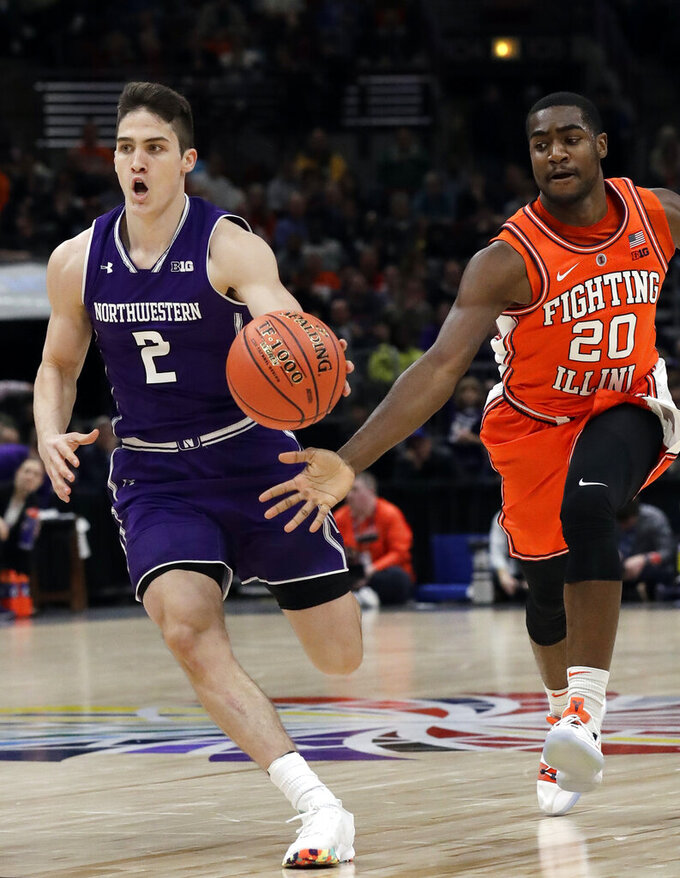 Northwestern guard Ryan Greer, left, drives to the basket past Illinois guard Da'Monte Williams during the first half of an NCAA college basketball game in the first round of the Big Ten Conference tournament in Chicago, Wednesday, March 13, 2019. (AP Photo/Nam Y. Huh)
