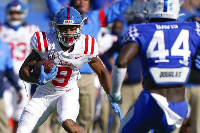 Mississippi running back Jerrion Ealy (9) runs with the ball during the first half of an NCAA college football game against Kentucky, Saturday, Oct. 3, 2020, in Lexington, Ky. (AP Photo/Bryan Woolston)