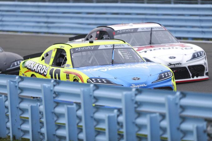 Brandon Jones (19) passes Harrison Burton, right, while going through esses during a NASCAR Xfinity Series auto race at Watkins Glen International in Watkins Glen, N.Y., on Saturday, Aug. 7, 2021. (AP Photo/Joshua Bessex)