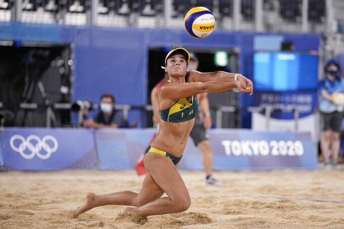 Mariafe Artacho del Solar, of Australia, stretches for the ball during a women's beach volleyball quarterfinal match against Canada at the 2020 Summer Olympics, Tuesday, Aug. 3, 2021, in Tokyo, Japan. (AP Photo/Felipe Dana)