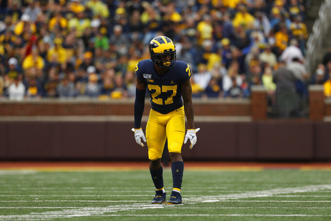 """FILE - Michigan defensive back Hunter Reynolds (27) plays against Rutgers in the second half of an NCAA college football game in Ann Arbor, Mich., Saturday, Sept. 28, 2019. This summer college athletes have organized campus marches, threatened boycotts, and been trending on social media as if they had just scored game-winning touchdowns without stepping foot on a field. """"The scale of the discussions was never what it is right now,"""" said Michigan defensive back Hunter Reynolds, a College Athlete Unity founder. (AP Photo/Paul Sancya, File)"""