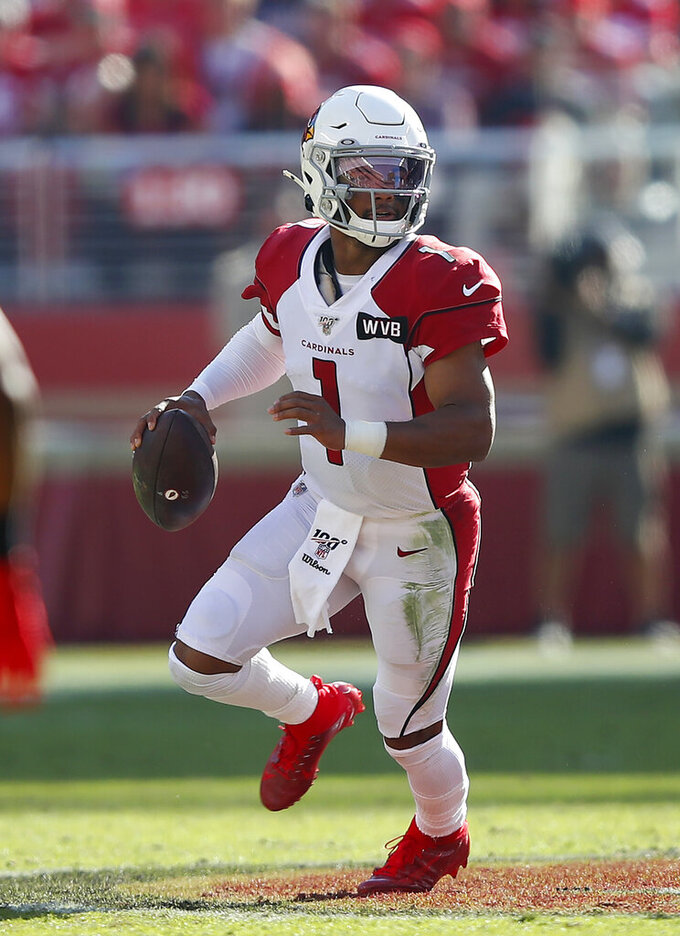 Arizona Cardinals quarterback Kyler Murray (1) rolls out against the San Francisco 49ers during the first half of an NFL football game in Santa Clara, Calif., Sunday, Nov. 17, 2019. (AP Photo/John Hefti)