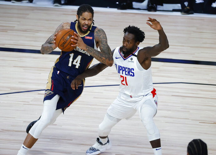 New Orleans Pelicans' Brandon Ingram, left, drives past Los Angeles Clippers' Patrick Beverley during an NBA basketball game Saturday, Aug. 1, 2020, in Lake Buena Vista, Fla. (Kevin C. Cox/Pool Photo via AP)