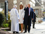 President Donald Trump with first lady Melania Trump,  and Reverend Bruce McPherson, waves to media as he arrives to attend service at Saint John's Church in Washington, Sunday, March 17, 2019 (AP Photo/Carolyn Kaster)