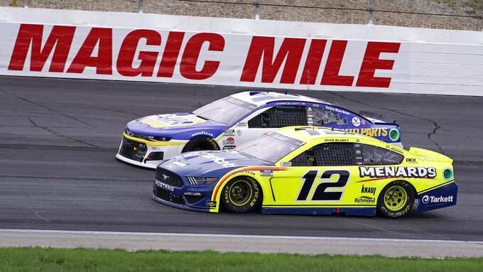 Ryan Blaney (12) and Chase Elliott drive side-by-side at a NASCAR Cup Series auto race, Sunday, July 18, 2021, in Loudon, N.H. (AP Photo/Charles Krupa)
