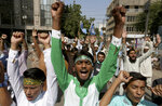 Supporters of the Muslims Students Organization chant slogans during a protest against French President and against the publishing of caricatures of the Prophet Muhammad they deem blasphemous, in Karachi, Pakistan, Friday, Oct. 30, 2020. Muslims have been calling for both protests and a boycott of French goods in response to France's stance on caricatures of Islam's most revered prophet. (AP Photo/Fareed Khan)