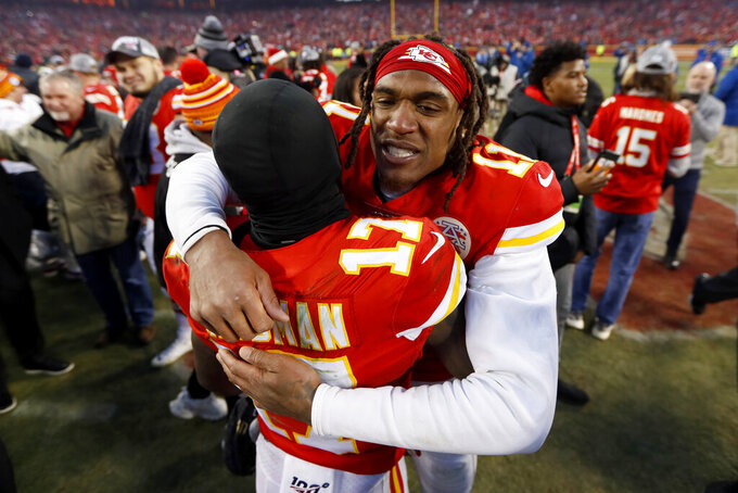 Kansas City Chiefs' Demarcus Robinson (11) and Mecole Hardman (17) celebrate after the NFL AFC Championship football game against the Tennessee Titans Sunday, Jan. 19, 2020, in Kansas City, MO. The Chiefs won 35-24 to advance to Super Bowl 54. (AP Photo/Charlie Neibergall)