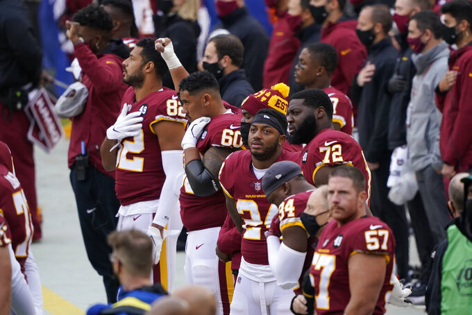 Members of the Washington Football Team on the sidelines before the start of the first half of an NFL football game against Dallas Cowboys, Sunday, Oct. 25, 2020, in Landover, Md. (AP Photo/Susan Walsh)