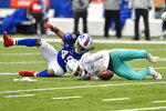 Miami Dolphins quarterback Tua Tagovailoa (1) is sacked by Buffalo Bills middle linebacker Tremaine Edmunds (49) in the first half of an NFL football game, Sunday, Jan. 3, 2021, in Orchard Park, N.Y. (AP Photo/Adrian Kraus)