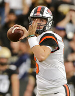 Oregon State quarterback Jake Luton looks to throw against Colorado during the second half of an NCAA football game, Saturday, Oct. 27, 2018, in Boulder, Colo. (AP Photo/Jack Dempsey)