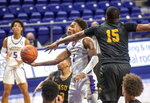 James Madison guard Matt Lewis (1) tries to put a shot against Norfolk State forward J.J. Matthews (15) during the second half of an NCAA basketball game in Harrisonburg, Va., Friday, Nov. 27, 2020. (Daniel Lin/Daily News-Record via AP)