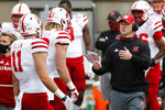 Nebraska head coach Scott Frost, right, talks with players during the first half of their NCAA college football game against Ohio State Saturday, Oct. 24, 2020, in Columbus, Ohio. Ohio State defeated Nebraska 52-17. (AP Photo/Jay LaPrete)