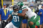 FILE - In this Oct. 27, 2019, file photo, Jacksonville Jaguars defensive end Yannick Ngakoue (91) rushes New York Jets offensive tackle Chuma Edoga during the first half of an NFL football game in Jacksonville, Fla. Standout defensive end Yannick Ngakoue no longer wants to sign a long-term deal with the Jacksonville Jaguars. Ngakoue announced his desire to play elsewhere via social media Monday, March 2, 2020, a move that could force the team to place the franchise tag on the 24-year-old disgruntled defender and trade him.(AP Photo/Stephen B. Morton, File)