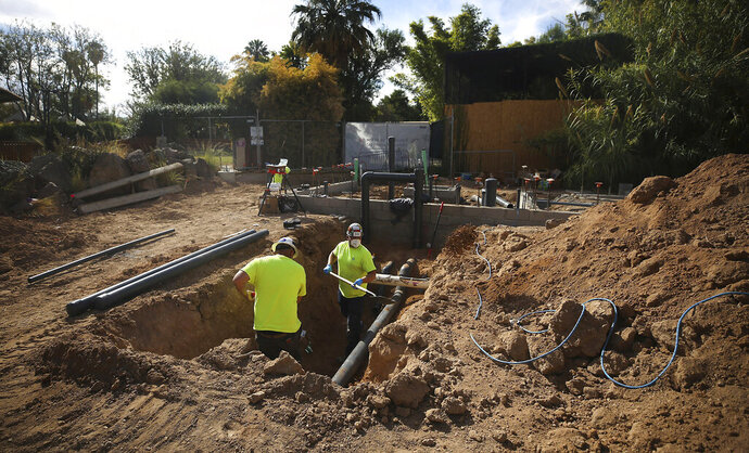 Construction continues on the new flamingo habitat at the Reid Park Zoo in Tucson, Ariz., Thursday, Nov. 12, 2020. Reid Park Zoo is taking the next steps in an ambitious decade-long, $80 million expansion plan. (Mamta Popat/Arizona Daily Star via AP)