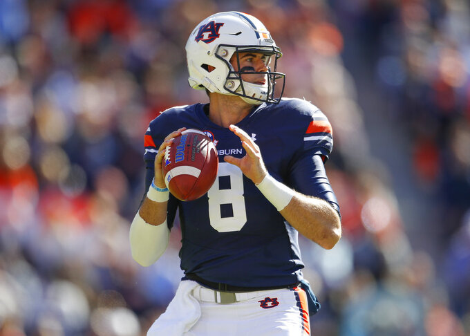 Auburn quarterback Jarrett Stidham (8) drops back to pass against Texas A&M during the first half of an NCAA college football game, Saturday, Nov. 3, 2018, in Auburn, Ala. (AP Photo/Todd Kirkland)