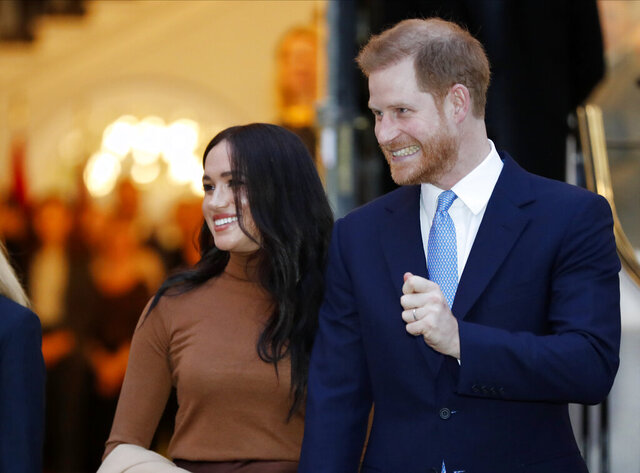 FILE - In this Tuesday Jan. 7, 2020 file photo Britain's Prince Harry and Meghan, Duchess of Sussex leave after visiting Canada House in London after their recent stay in Canada. In a stunning declaration, Britain's Prince Harry and his wife, Meghan, said they are planning