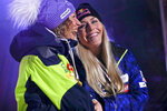 Winner Slovenia's Ilka Stuhec, left, and third placed United States' Lindsey Vonn share a laugh during the medal ceremony for the women's downhill race at the alpine ski World Championships in Are, Sweden, Sunday, Feb.10, 2019. (AP Photo/Alesssandro Trovati)
