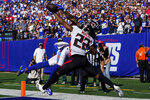 Atlanta Falcons cornerback Fabian Moreau (22) breaks up a pass to New York Giants wide receiver Kenny Golladay (19) in the end zone during the second half of an NFL football game, Sunday, Sept. 26, 2021, in East Rutherford, N.J. (AP Photo/Seth Wenig)