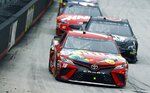 Kyle Busch leads Trevor Bayne and Kurt Busch (41) during a NASCAR Cup Series auto race, Monday, April 16, 2018, in Bristol, Tenn. Kyle Busch won the rain-delayed race. (AP Photo/Wade Payne)