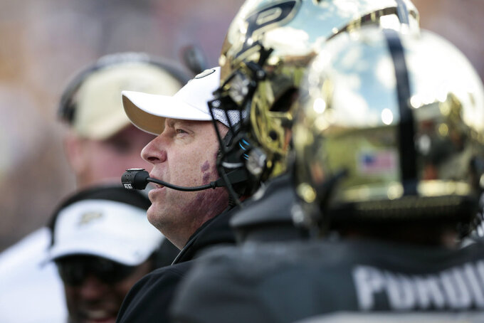 Purdue head coach Jeff Brohm talks to his team while playing against Iowa in the first half of an NCAA college football game in West Lafayette, Ind., Saturday, Nov. 3, 2018. (AP Photo/AJ Mast)