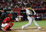 Oakland Athletics' Matt Chapman hits a two-run home run against the Los Angeles Angels during the fifth inning of a baseball game Saturday, June 29, 2019, in Anaheim, Calif. (AP Photo/Marcio Jose Sanchez)