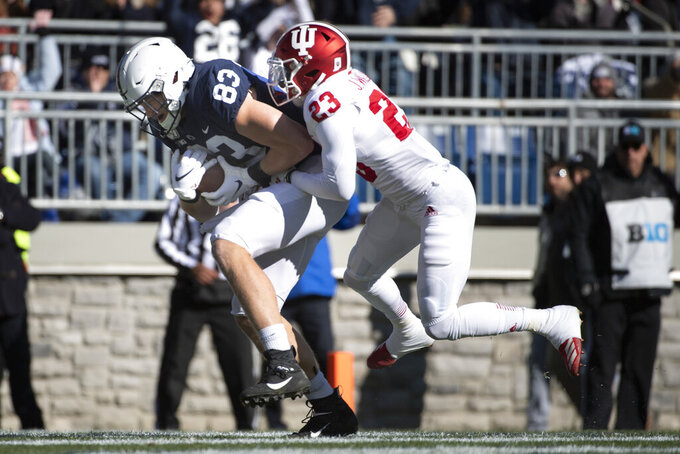 Penn State tight end Nick Bowers (83) catches a touchdown pass as Indiana defensive back Jaylin Williams (23) defends in the first quarter of an NCAA college football game in State College, Pa., on Saturday, Nov. 16, 2019. (AP Photo/Barry Reeger)
