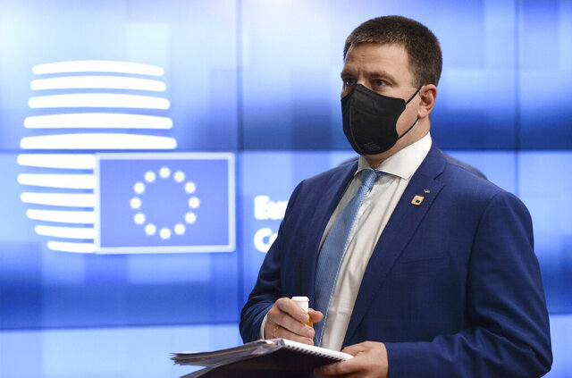 FILE - In this file photo dated Friday, Oct. 16, 2020, Estonia's Prime Minister Juri Ratas leaves from an EU summit in Brussels. Ratas has handed in his resignation, Wednesday Jan. 13, 2021,  after a corruption scandal investigated by the police and prosecutors in his Center Party led to key party officials resigning, while Ratas said he personally has not done anything wrong. (Johanna Geron, File Pool via AP)