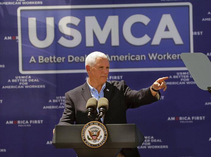 Vice President Mike Pence speaks to a crowd of over 500 supporters at Elite Well Services in Artesia, NM. Wednesday, Aug. 21, 2019. Pence linked the future prosperity of the U.S. energy sector to approval this year of the U.S.-Mexico-Canada Agreement,  (Jim Thompson/The Albuquerque Journal via AP)