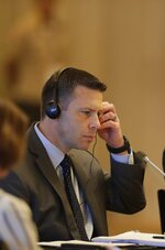 Acting U.S. Homeland Security Secretary Kevin McAleenan adjust his headphones during a meeting with Central American and Colombia's security ministers, in Panama City, Thursday, Aug. 22, 2019. McAleenan is in Panama to discuss drug trafficking and migrant smuggling, though he says he isn't seeking any specific agreement during the visit. (AP Photo/Arnulfo Franco)