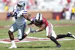 Kansas State running back Jacardia Wright (9) stiff arms Oklahoma defensive back Tre Brown (6) during an NCAA college football game, Saturday, Sept. 26, 2020, in Norman, Okla. (Ian Maule/Tulsa World via AP)d