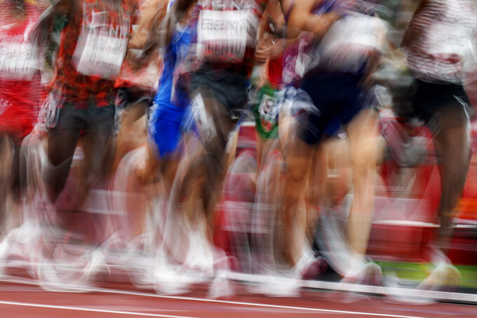 Runners compete in a heat of the men's 5,000-meters at the 2020 Summer Olympics, Tuesday, Aug. 3, 2021, in Tokyo. (AP Photo/Petr David Josek)