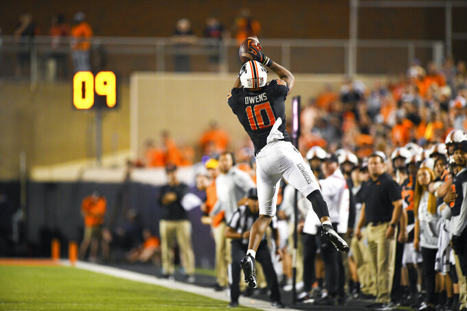 Oklahoma State wide receiver Rashod Owens (10) leaps to retrieve a catch for an 18 yard pass during an NCAA college football game Saturday, Sept. 25, 2021, in Stillwater, Okla. (AP Photo/Brody Schmidt)