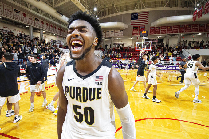 Purdue forward Trevion Williams celebrates the team's 59-56 win over Virginia Commonwealth in an NCAA college basketball game at the Emerald Coast Classic in Niceville, Fla., early Saturday, Nov. 30, 2019. (AP Photo/Mark Wallheiser)