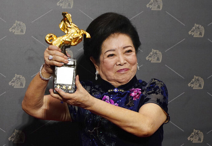 Taiwanese actress Chen Shu-fang holds her award for Best Supporting Actress at the 57th Golden Horse Awards in Taipei, Taiwan, Saturday, Nov. 21, 2020. Chen won for the film
