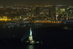 FILE - This Oct. 7, 2014, file photo, shows the Statue of Liberty during a visit by President Barack Obama, in New York. (AP Photo/Evan Vucci, File)