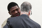 Former Ohio State football player Jahsen Wint, left, consults with his attorney, Sam Shamansky, right, following his arraignment on Thursday, Feb. 13, 2020 at the Franklin County Municipal Courthouse in Columbus, Ohio. Wint, who was dismissed from the team on Feb. 12, 2020, along with teammate and co-defendant Amir Riep, are charged with the rape and kidnapping of a 19-year-old woman on Feb. 4, 2020 at an apartment the two men share. (Joshua A. Bickel/The Columbus Dispatch via AP)