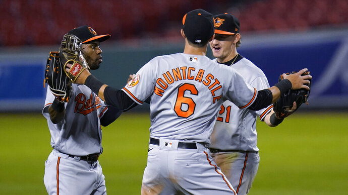 Baltimore Orioles' Cedric Mullins, left, celebrates with Ryan Mountcastle (6) and Austin Hays after the team's 13-1 win over the Boston Red Sox in a baseball game at Fenway Park in Boston, Thursday, Sept. 24, 2020. (AP Photo/Charles Krupa)