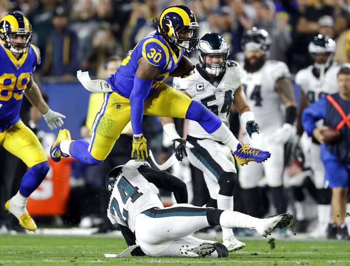 FILE - In this Dec. 16, 2018, file photo Los Angeles Rams running back Todd Gurley runs against the Philadelphia Eagles during the first half in an NFL football game in Los Angeles. Gurley still is not shedding much light on the injured knee that limited him down the stretch with the Rams. He was in camp for the opening of the Rams' offseason program Monday, April 15, 2019, in their first team activities since their Super Bowl loss to New England. (AP Photo/Marcio Jose Sanchez, File)